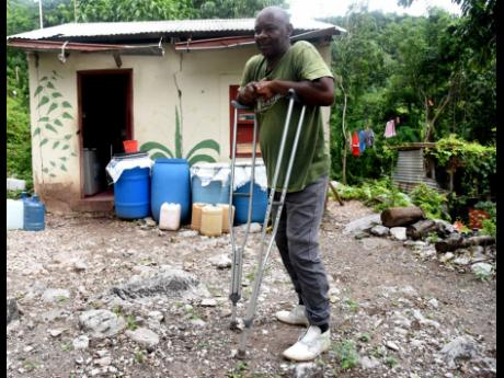 Bito resident Wayne Hibbert Says although being marooned poses a challenge for residents of the St Andrew community, it gives them reprieve from praedial thieves.