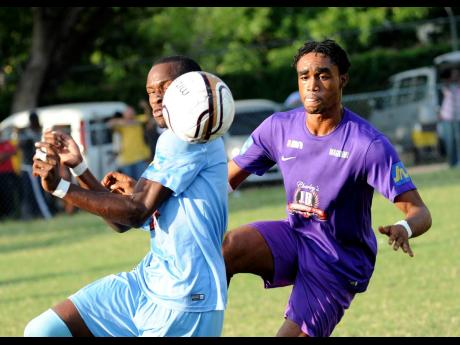 Molynes United's Zavian Williams (right) duels with Central Kingston's Romario Davey during a Magnum/KSAFA Super League match at the Barbican Complex in 2016.