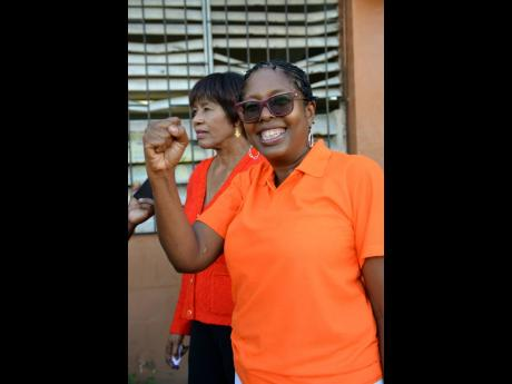 Angela Brown Burke is seen here with Portia Simpson Miller, predecessor MP of St Andrew South West.