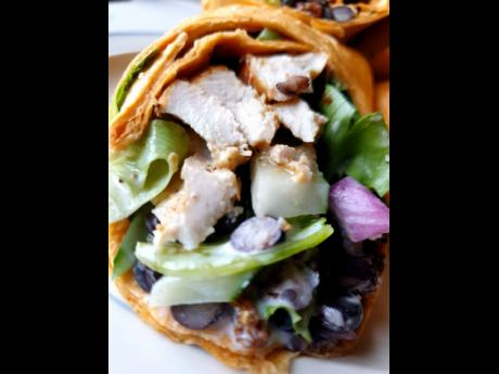 The tasty pan-seared chicken and black bean wrap will have you filled and happy in no time.