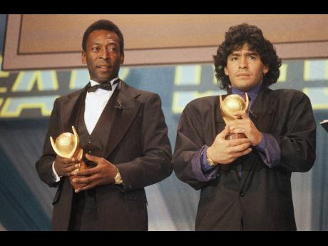 "FILE - In this March 1987 file photo, Pele, left, and Maradona hold ""Sports Oscar"" trophies in Milan, Rome. The Argentine soccer great who was among the best players ever and who led his country to the 1986 World Cup title before later struggling with"