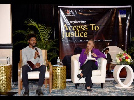 Jamaicans for Justice Executive Director Rodje Malcolm speaking with journalist Dionne Jackson-Miller during the question-and-answer section at yesterday's public forum and research dissemination seminar at The Jamaica Pegasus Hotel in New Kingston.