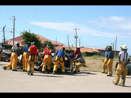 Members of the Hanover branch of the Jamaica Fire Brigade participate in an extrication technique exercise.