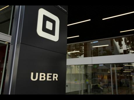 This Wednesday, June 21, 2017 file photo shows the building that houses the headquarters of Uber, in San Francisco. Uber can keep operating in London after the ride-hailing company won a court appeal on Monday, September 28, against the refusal by transit