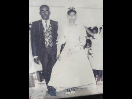 Moreen Francis and her give away father entering the St.Ann's Baptist Church on her wedding day.