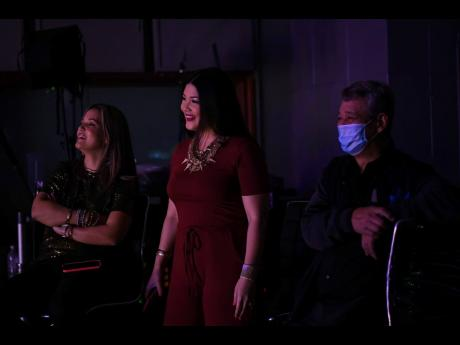 Tami Chin Mitchell (left) and sister, Tessanne Chin, share a moment with father, Richard Chin, backstage at Appleton Estate 'Reserve the Night' live-stream.