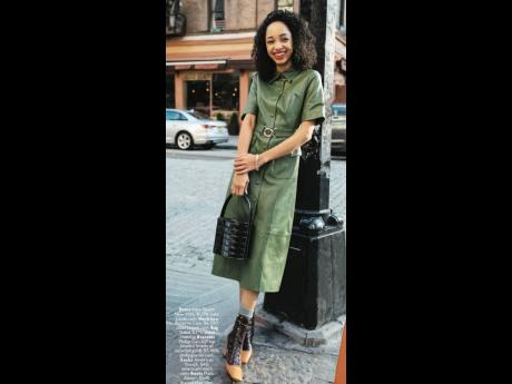 Donning a sleek olive-toned leather dress, Daniella Davis gave fashion lovers even more options with an easy day to evening look.