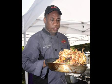 Chef Ebanks is caught in action during a live demonstration.