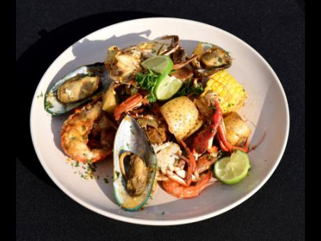 A closer look at the seafood extravaganza – lobster, shrimp, mussels, crab, Irish potatoes and sweetcorn simmered in a famous citrusy sweet and spicy sauce.