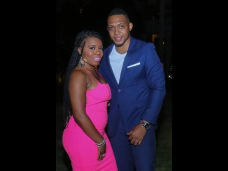 Jaquline Dyer-Turner (left) and Adrian Turner surely turned heads at the New Year's Eve soirée, with Jaquline in form-fitting pink and Adrian in a casual navy suit.