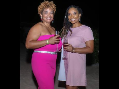 Kiana Case (left) and Kymoya Case were vibrant and playful dressed in shades pink and mauve.