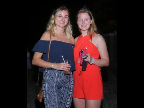 Fire and ice: Karina Kostova (left) and Melissa Kote enjoy the festivities. Kote sports a fiery, red-orange romper, while Kostova opted for calm, cool blue.