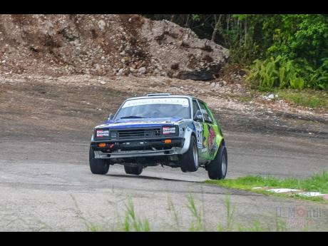 Bajan Mark Thompson goes up on two wheels in his old school Toyota Starlet in the 's curves' at Dover Raceway.