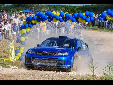 John Powell and Nicholas Telfer exits the Watersplash in their Subaru Impreza S14 WRC '08 on their way to winning Rally Jamaica 2011.