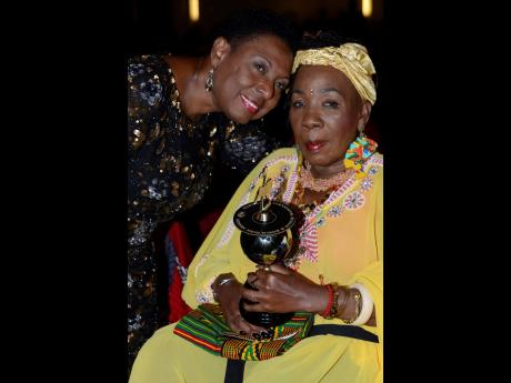 Olivai Grange Minister of Culture, Gender, Entertaiment and Sports, poses with  Rita Marley shortly after she was presented with the International Reggae and World Music Awards (IRAWMA) durng the 37th staging at the Jamaica Pegasus Hotel in Kingston on Sat