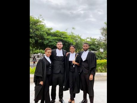 Young attorneys share lens time hours after passing the Bar. From left: Caleigh Reid, Duncan Roye, Ashley Innis and Syl-Don O'Gilvie