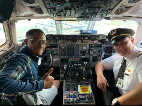 Daniel Buchanan in the cockpit with a first officer at Delta Air Lines and past student of Embry-Riddle Aeronautical University.