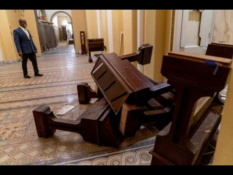 Some of the damage done after protesters stormed the Capitol in Washington, last week Wednesday.