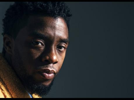 In this February 14, 2018 photo, Chadwick Boseman poses for a portrait in New York to promote 'Black Panther'.