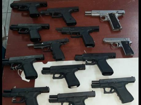 The 13 handguns which were among 19 firearms illegally shipped into Montego Bay from a Florida address in the United States. The weapons and an assortment of ammunition were seized on Monday.