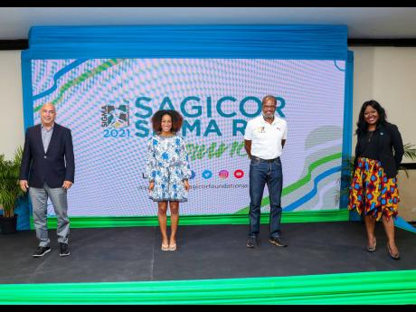 (From left) Christopher Zacca, president and CEO, Sagicor Group Jamaica; Briana Williams, junior athletic champion and 2021 Sigma Run patron; Alfred 'Frano' Francis, race director; and Alysia White, executive director, Sagicor Foundation and Sigma Run