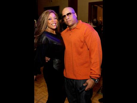 This March 25, 2011 file photo shows Wendy Williams and her husband Kevin Hunter at Aretha Franklin's 69th birthday party in New York. Williams filed for divorce after nearly 22 years of marriage to her husband and manager.