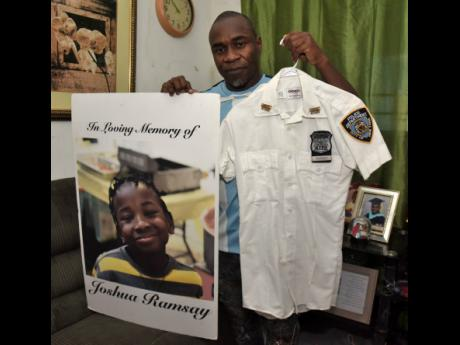 Kenroy Ramsay shows memorabilia of his son Joshua who died from cancer in 2019 after battling the scourge for almost five years.
