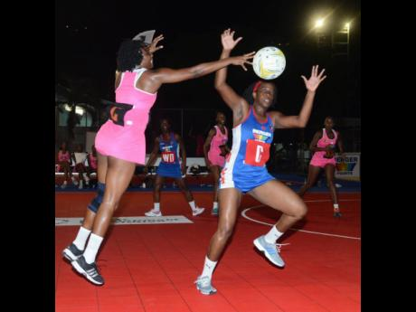 Kingston Hummingbirds' Mellisa Wright (left) and Suzette Case from the Clarendon Gaters challenge for the ball during a Berger Elite Netball match at Leila Robinson Courts on Friday, April 17, 2015.  Gaters won 32-31.