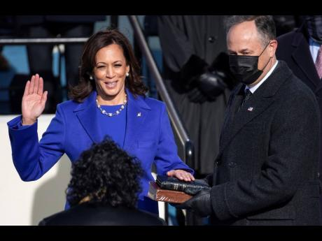 Kamala Harris is sworn in as the 49th US vice-president by Supreme Court Justice Sonia Sotomayor on Wednesday, January 20 at the Capitol in Washington.