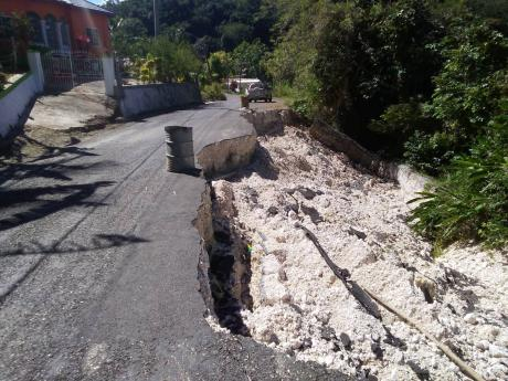 A damaged section of the Jointwood main road in St Elizabeth, which residents say pose a danger to unsuspecting motorists since it collapsed last November during heavy rainfall.