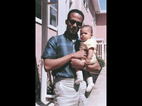 In this April 1965 photo, Donald Harris holds his daughter, Kamala.