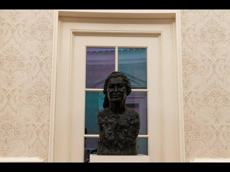 A bust of civil rights leader Rosa Parks sits atop a plinth inside the Oval Office.