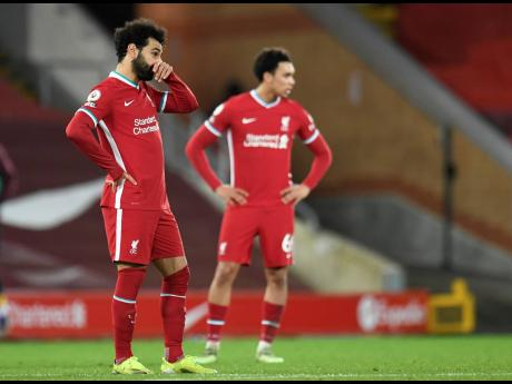 Liverpool's Mohamed Salah looks on after their English Premier League match against Burnley at Anfield Stadium in Liverpool, England, yesterday.