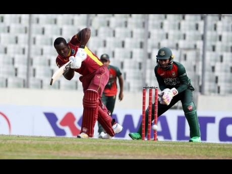 West Indies top scorer Rovman Powell gathers runs during the second One-Day International against hosts Bangladesh in Dhaka yesterday.