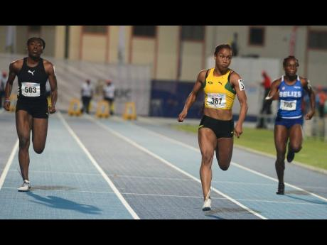 Jamaica's Briana Williams (centre) storms to victory in the Under–20 Girls 100m final at the 48th staging of the Carifta Games at the Truman Bodden Sports Complex in George Town, Cayman Islands, on Sunday, April 21, 2019.