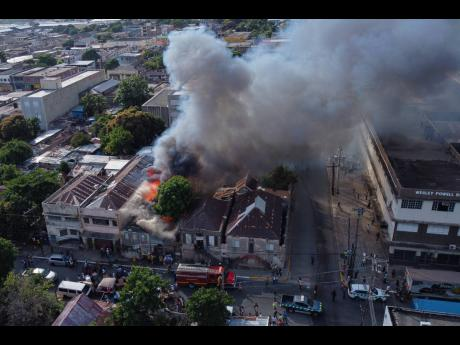 Fire in the heart of the Kingston capital on December 23, 2020. Insurance penetration is low among businesses for fire and other damage.