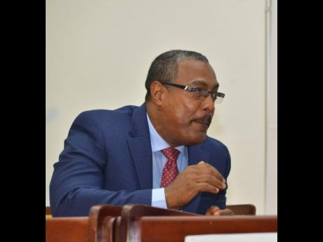 Postmaster General and CEO of the Postal Corporation of Jamaica, Michael Gentles.