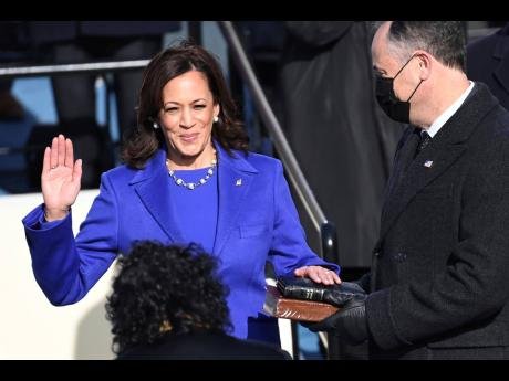 Kamala Harris is sworn in as vice president by Supreme Court Justice Sonia Sotomayor as her husband Doug Emhoff holds the Bible during the 59th Presidential Inauguration at the US Capitol in Washington on Wednesday.