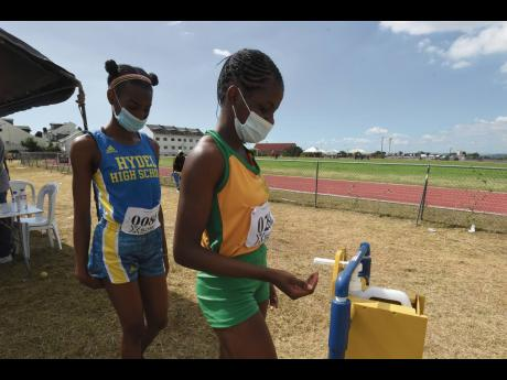 Athletes sanitise their hands during the Tyser Mills Classics at Calabar High School on Saturday, December 12, 2020.