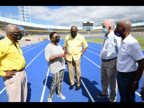 Independence Park Chairman Mike Fennell (second right), General Manager Major Desmon Brown (left), Sports Minister Olivia Grange (second left), Jamaica Athletics Administrative Association (JAAA) Vice President Ian Forbes (centre), and JAAA President Garth