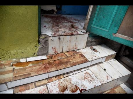 Bloodstains mark the floor where siblings  24-year-old Ginel Thomas and 29-year-old Omar Jarrett were killed on Penn Street, Kingston.