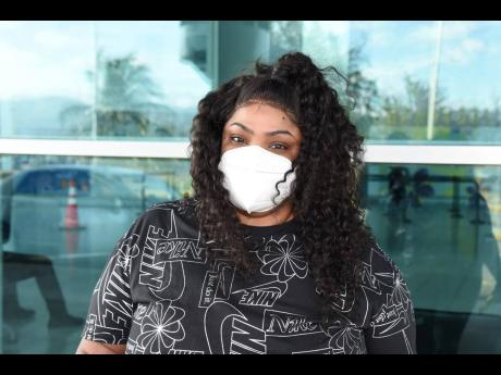 Davia Keise is seen at the Norman Manley International Airport on Tuesday. She was cleared with her COVID-19 passport for her return to the United States.