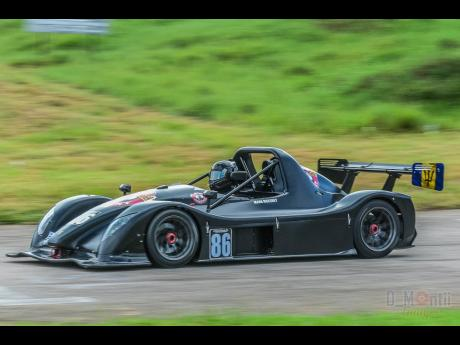 Mark Maloney pilots his Radical vehicle around the Dover race track.