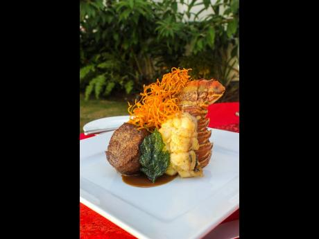 Butter poached lobster tail and roasted beef tenderloin served with dauphinoise potatoes, seasonal vegetables and truffle sauce.