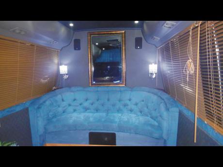 A sofa built into a bus.