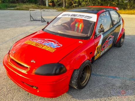 Circuit racer Ricardo Scott is impatient for the post COVID-19  racing season to start, so he can showoff the new paint scheme on his rebuilt Honda Civic race car.
