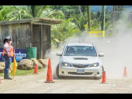 Jason Bailey takes his Subaru SG-T through its paces during a dirt dexterity event pre COVID-19.