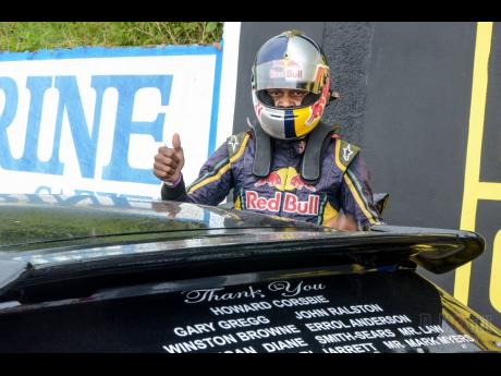 Circuit racing champion Collin Daley Jnr gives a thumbs up before a race at Dover.