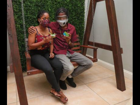 Shanice Bramwell and her beau, Jardane Oliphant, pause for a photo after enjoying a tasty meal at Kingston's Julie Mango restaurant. The couple won a gift certificate to the restaurant for correctly answering a question posted to Sagicor Group Jamaica'