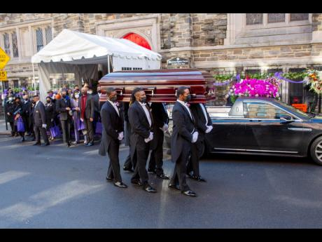 Pall-bearers carry the casket of pioneering black actress Cicely Tyson from Harlem's famed Abyssinian Baptist Church to a hearse on Tuesday.